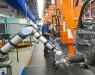На заводе BMW роботы впервые стали работать бок о бок с людьми